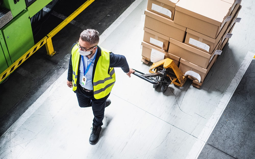 top view of factory worker with a contact tracing solution wearable